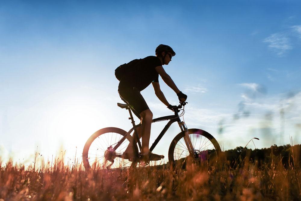 Man riding bike in a field