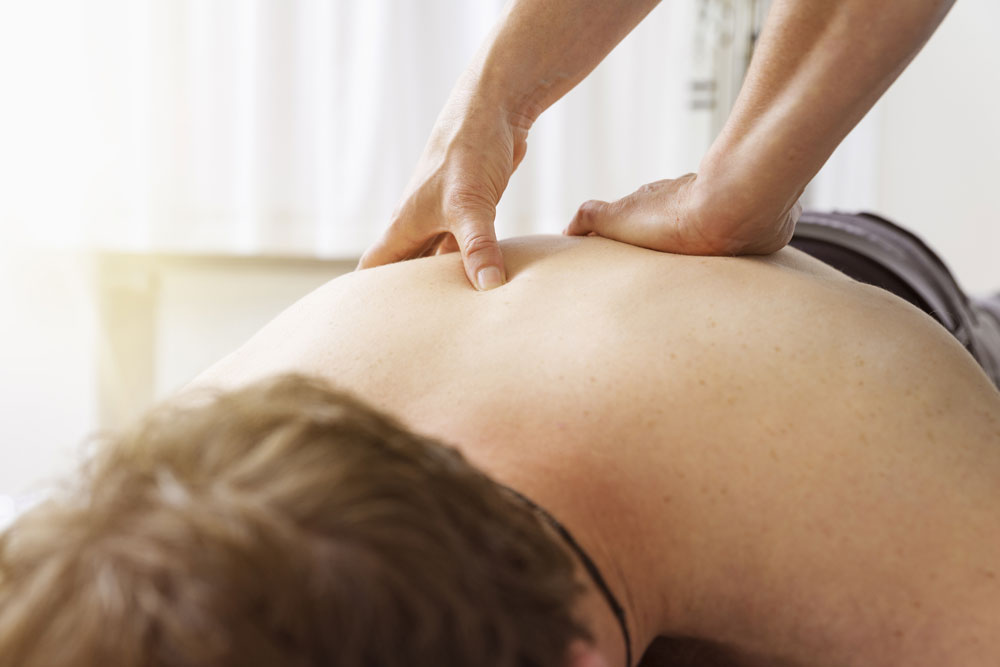 Man getting a remedial deep tissue back massage