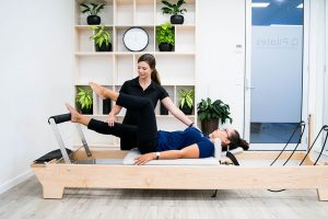 Pilates instructor demonstrating clinical exercise