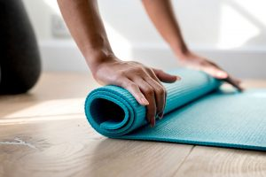 Lady rolling up exercise mat