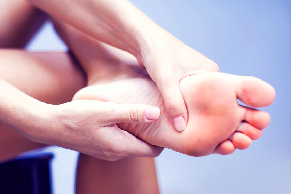 Woman holding sore foot