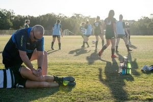 Physiotherapist treating at western pride football club