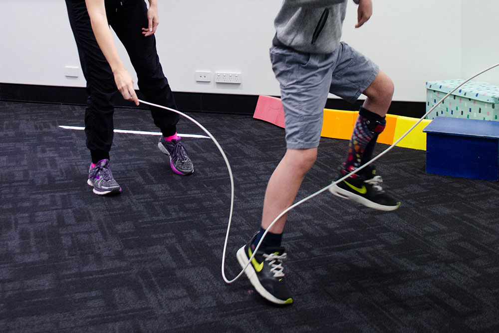 Q Paediatrics skipping rope with child