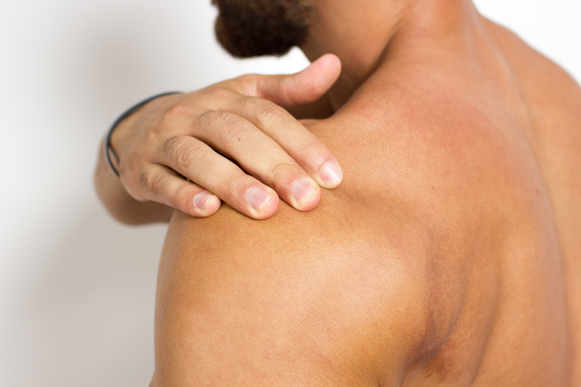 Man holding his shoulder from shoulder pain