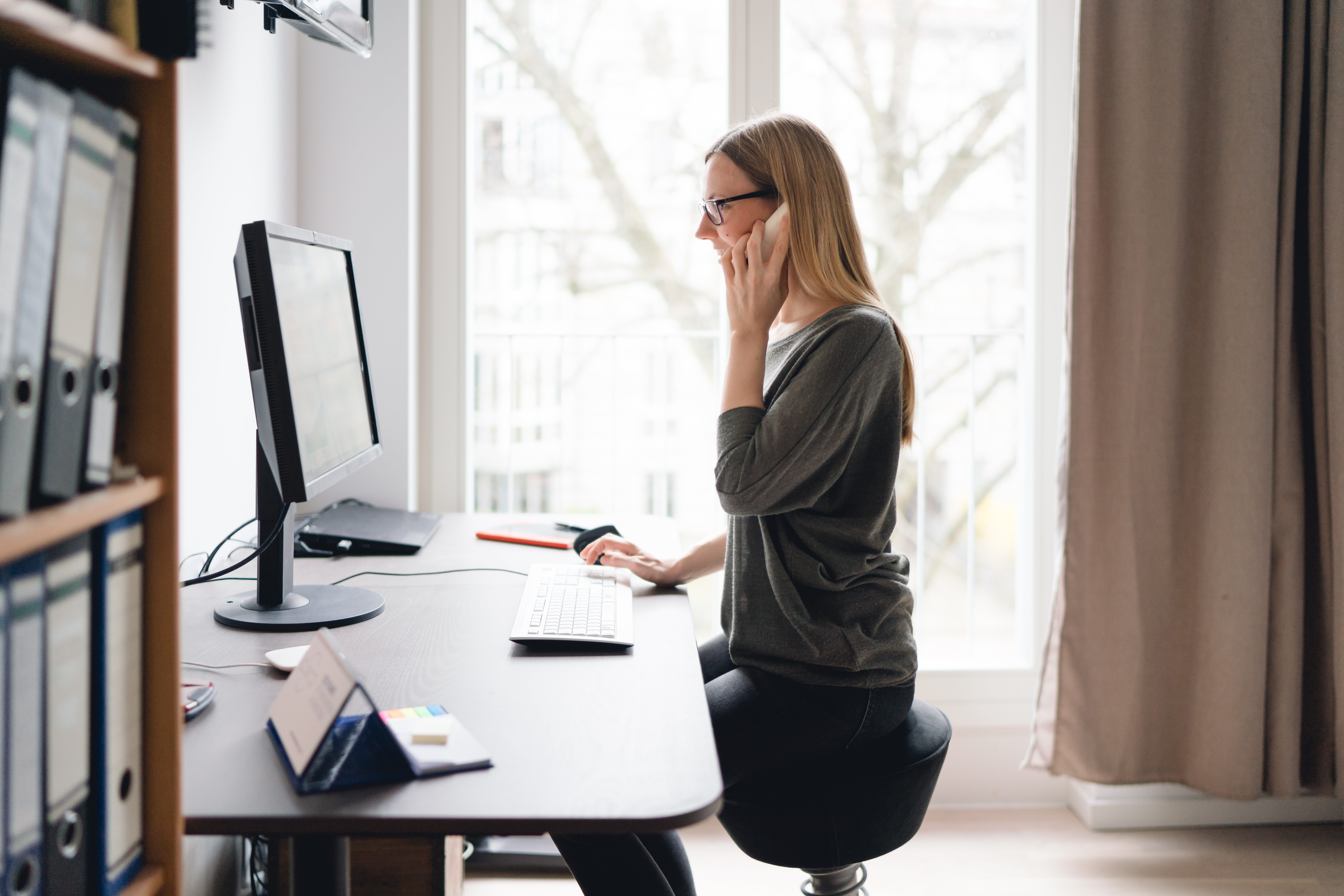 Woman working from home on an ergonomic set up